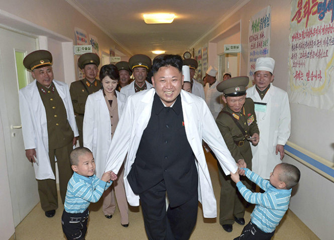"""North Korean leader Kim Jong un (C) plays with children during a visit to the Taesongsan General Hospital in this undated photo released by North Korea's Korean Central News Agency (KCNA) in Pyongyang May 19, 2014. Kim is suffering from """"discomfort"""", state media has said in the first official acknowledgement of ill health after a prolonged period out of the public eye. Kim, 31, who is frequently the centrepiece of the isolated country's propaganda, has not been photographed by state media since appearing at a concert alongside his wife on September 3, fuelling speculation he is suffering from bad health. He had been seen walking with a limp since an event with key officials in July and in a pre-recorded documentary broadcast by state media on September 25, 2014 appeared to have difficulty walking. REUTERS/KCNA (NORTH KOREA - Tags: POLITICS HEALTH TPX IMAGES OF THE DAY) ATTENTION EDITORS - THIS PICTURE WAS PROVIDED BY A THIRD PARTY. REUTERS IS UNABLE TO INDEPENDENTLY VERIFY AU NTICITY, CONTENT, LOCATION OR DATE THIS IMAGE THIS PICTURE IS DISTRIBUTED EXACTLY AS RECEIVED BY REUTERS, AS A SERVICE TO CLIENTS FOR EDITORIAL USE ONLY. NOT FOR SALE FOR MARKETING OR ADVERTISING CAMPAIGNS. THIS IMAGE HAS BEEN SUPPLIED BY A THIRD PARTY. IT IS DISTRIBUTED, EXACTLY AS RECEIVED BY REUTERS, AS A SERVICE TO CLIENTS. NO THIRD PARTY SALES. NOT FOR USE BY REUTERS THIRD PARTY DISTRIBUTORS. SOUTH KOREA OUT. NO COMMERCIAL OR EDITORIAL SALES IN SOUTH KOREA - RTR3PTH5"""