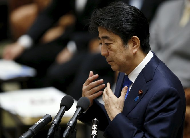 Japan's Prime Minister Shinzo Abe speaks at a lower house special committee session on security-related legislation at the parliament in Tokyo July 15, 2015. Legislation to implement a dramatic change in Japanese defence policy that could allow troops to fight abroad for the first time since World War Two was approved by a lower house panel on Wednesday, despite opposition from a majority of ordinary voters. REUTERS/Toru Hanai