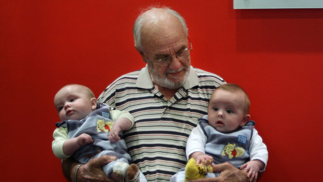 Portrait of James Harrison 72 (centre) with twin boys Seth Murray O+ (left) and Ethan Murray O-(right) in the Apheresis department at the Australian Red Cross Blood Service. Hundreds of thousands of babies owe their health and in some cases their life to James Harrison as his blood has been used in every dose of anti-D serum since 1967, which is given when the blood types of mothers and babies are incompatible. Red Cross, Sydney, NSW. Today 20th of May, 2009. Photo by KATE GERAGHTY.