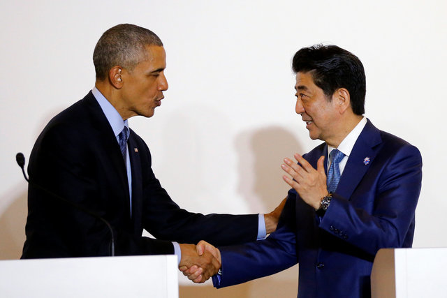 U.S. President Barack Obama shakes hands with Japan's Prime Minister Shinzo Abe during a press conference after a bilateral meeting during the 2016 Ise-Shima G7 Summit in Shima, Japan May 25, 2016. REUTERS/Carlos Barria