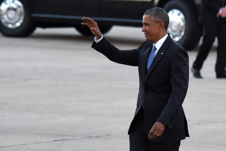 President Barack Obama waves as he approaches his supporters after arriving at Tinker Air Force Base, Wednesday, July 15, 2015, in Oklahoma City, Okla. (AP Photo/Tyler Drabek)