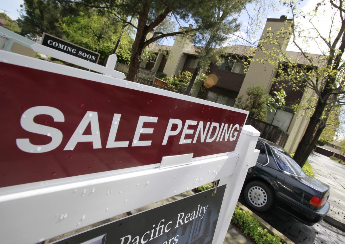 """A """"Sale Pending"""" sign is shown at a condo in Palo Alto, Calif., Monday, April 5, 2010. The number of buyers who agreed to purchase previously occupied homes rose sharply in February, far exceeding expectations, a report said Monday.(AP Photo/Paul Sakuma)"""