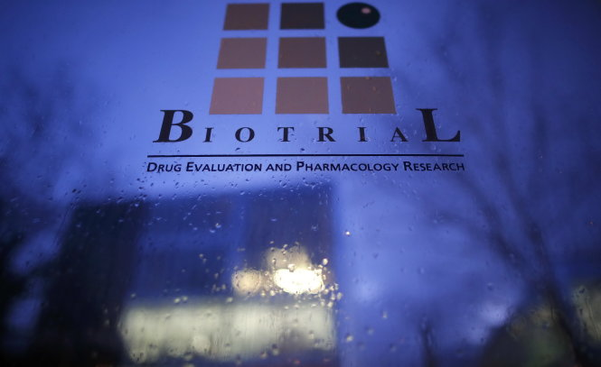 A logo is seen on a glass sign in front of the entrance of the Biotrial laboratory building in Rennes, France, January 15, 2016. Portugal-based Bial lab is the manufacturer of the experimental medicine that sent six male volunteers in a trial of the drug to hospital in France, French Health Minister Marisol Touraine said on Friday. Touraine said the drug, which was being tested in a Phase I trial in France by Biotrial for Bial, contained neither cannabis nor any substance derived from cannabis. REUTERS/Stephane Mahe