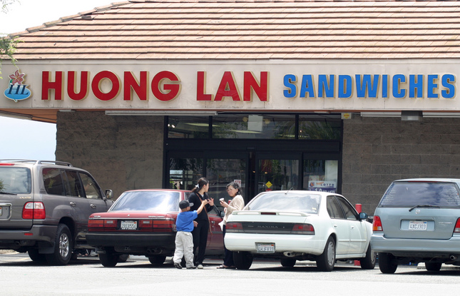 PHOTO BY THU HOANG LY  6/11/2003   Customers talk outside  Huong Lan Sandwiches on Tully Road in San Jose near Lee's Sandwiches. Owner of the shop has three locations.
